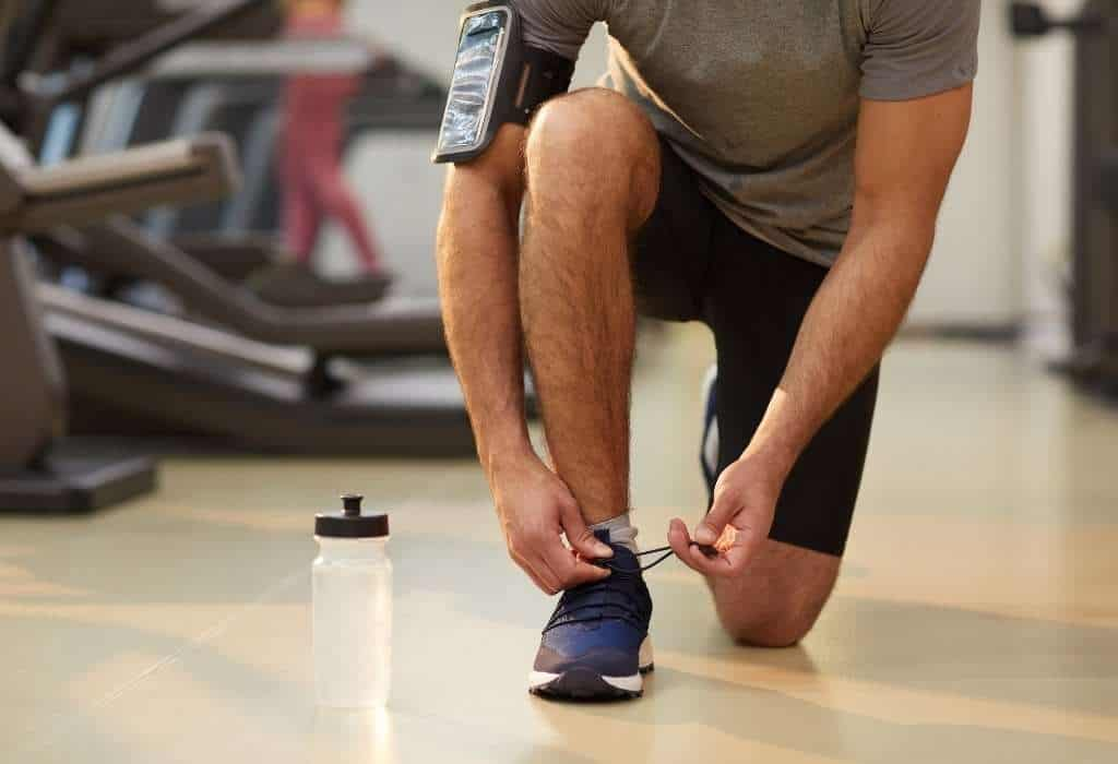 Man Ties Gym Shoes (what men shouldn't wear to the gym)