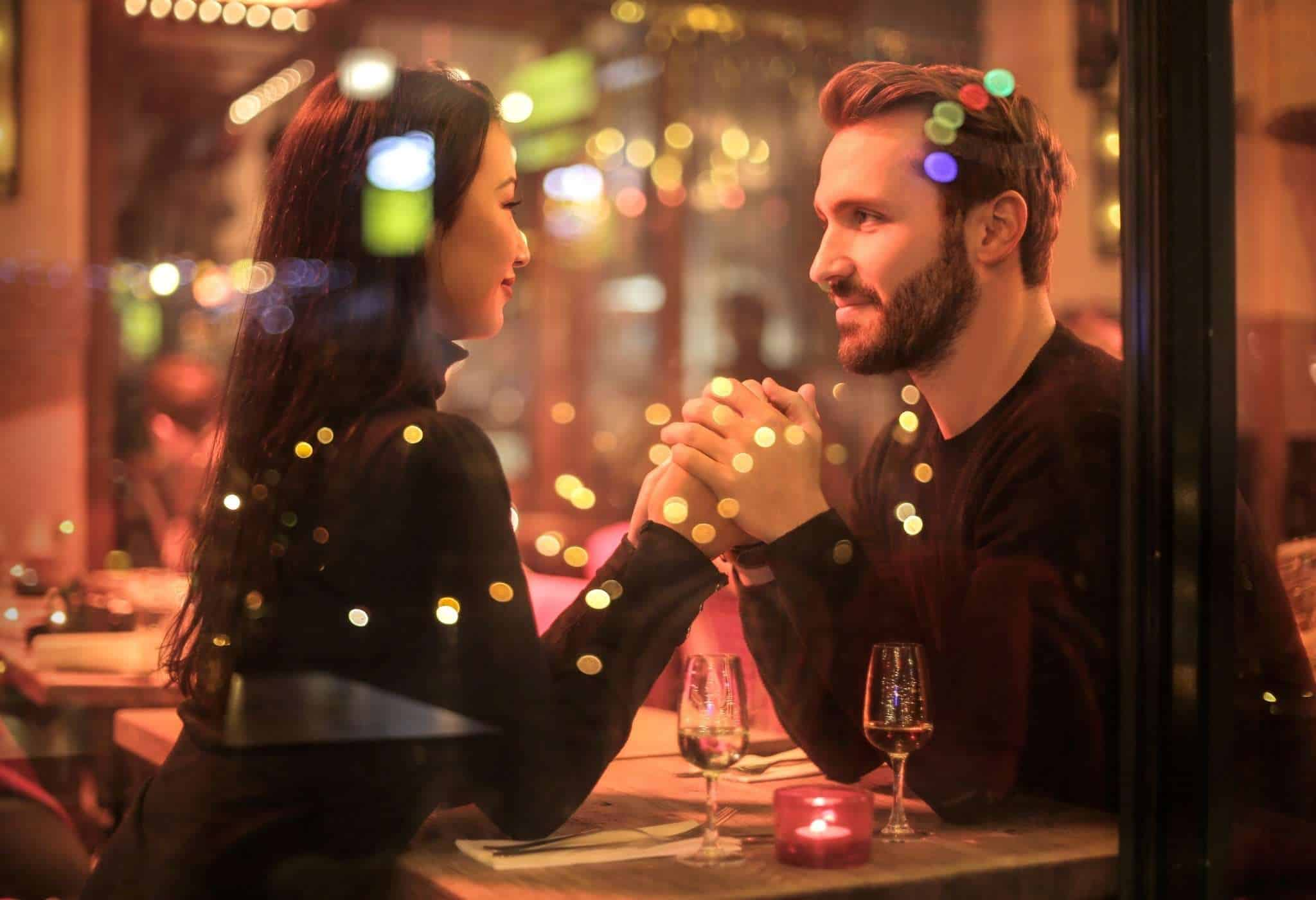 a man and woman making eye contact and smiling subtly