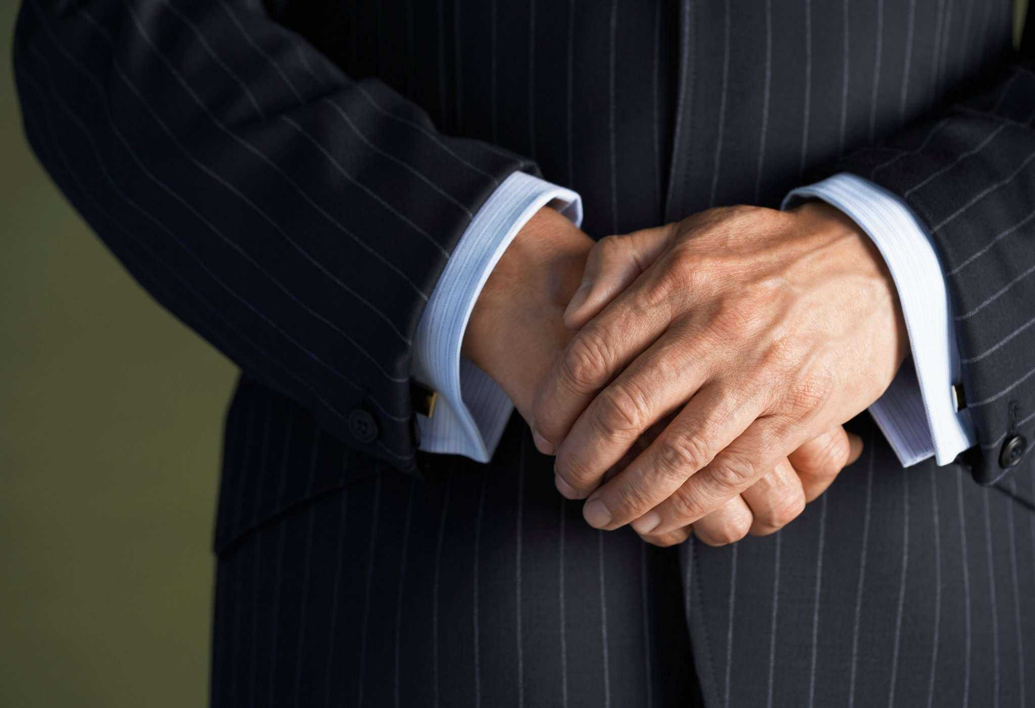 man in a suit with cuffs showing
