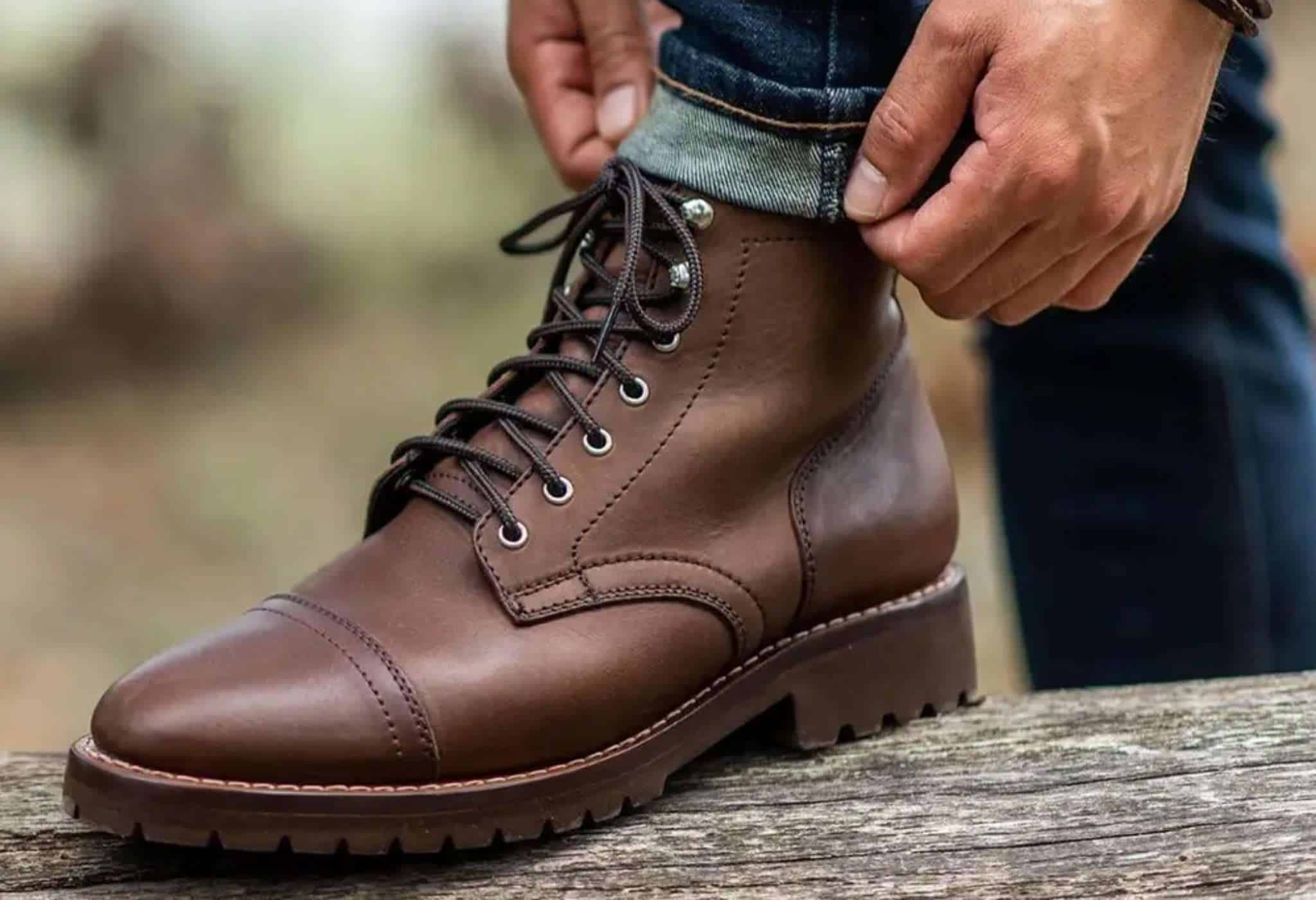 wearing clean leather boots with cuffed  jeans
