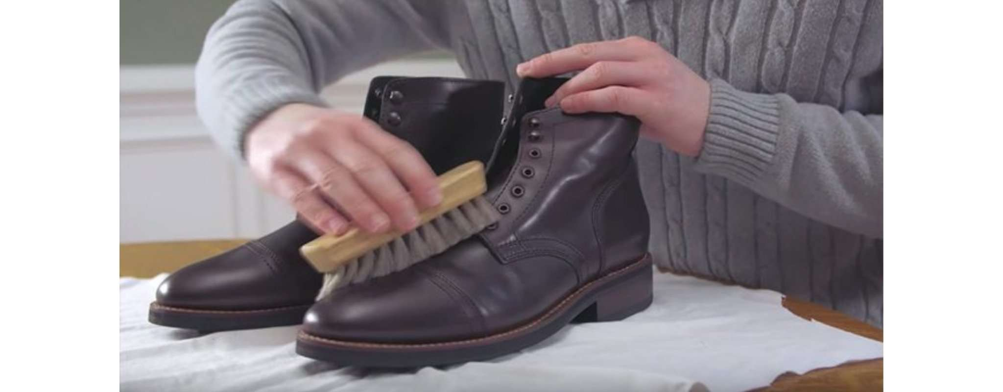 brushing leather shoes to clean
