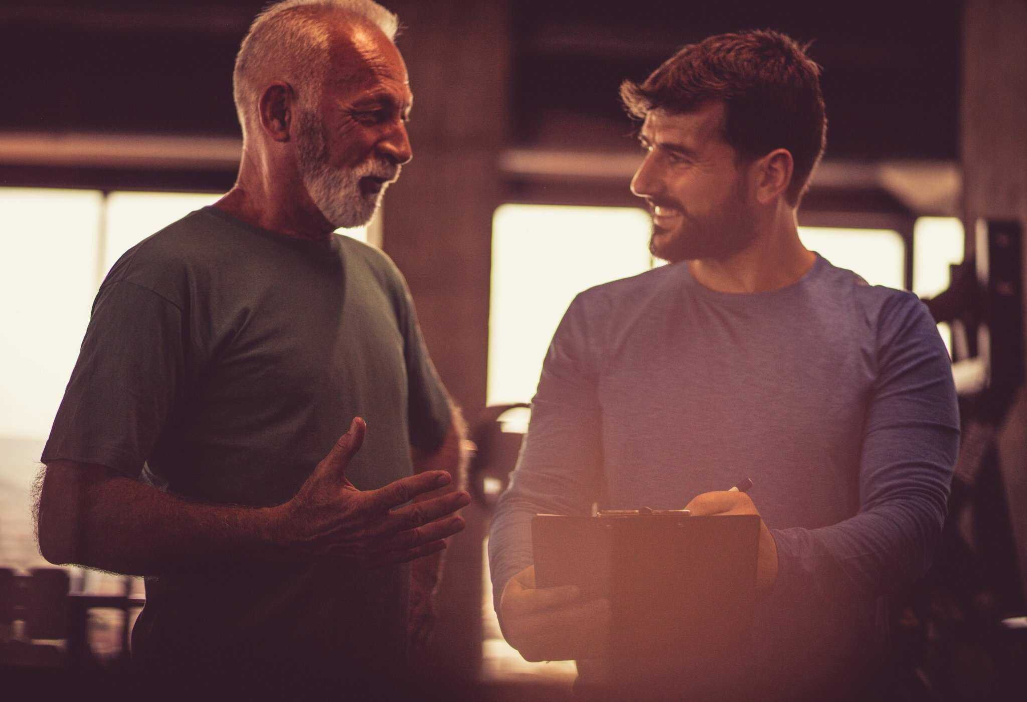 older man gives advice to younger